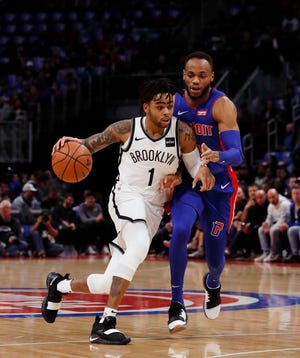 Brooklyn Nets guard D'Angelo Russell (1) drives on Pistons rookie Bruce Brown, who made his NBA debut on Wednesday.