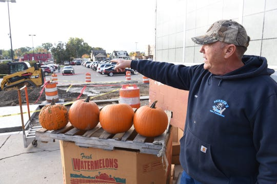 """Ken Penzien of Penzien Farms and Greenhouses in Macomb Township points to an area already under construction at the Royal Oak Farmers Market.   """"That used to be where I put my produce,"""" he said. """"That's where they say a street is going to go now. No room for me anymore."""""""