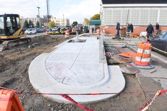 Construction is under way at the Royal Oak Farmers Market parking lot.  Moving two new structures on the site will eliminate all but about 100 parking spaces.