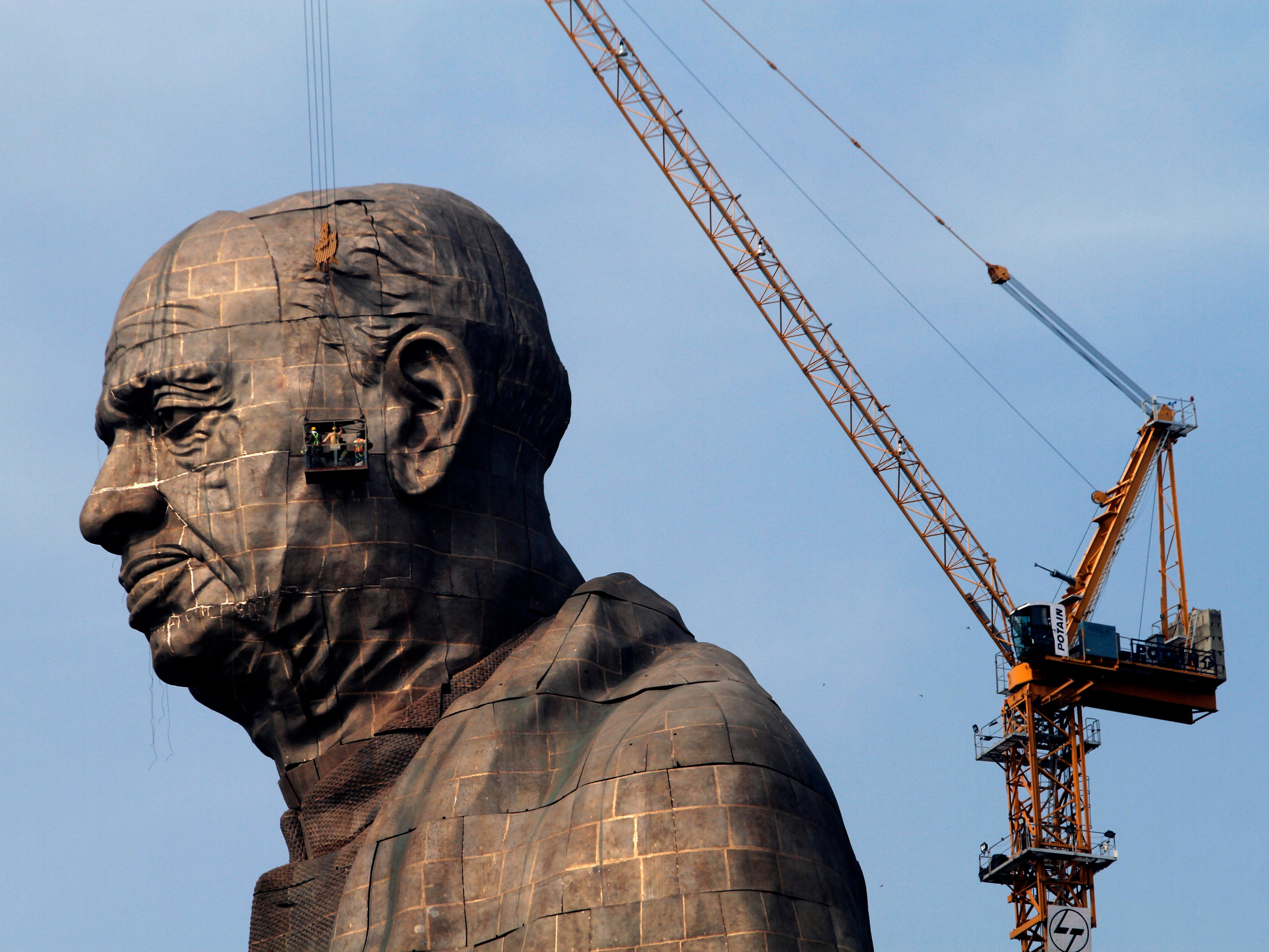 The under-construction Statue of Unity stands facing Sardar Sarovar Dam at Kevadiya Colony, India, Thursday, Oct. 18, 2018. The tribute to Indian freedom fighter Sardar Vallabhbhai Patel will be inaugurated on Oct. 31 by Prime Minister Narendra Modi, and is slated to be the one of the world's tallest statues.