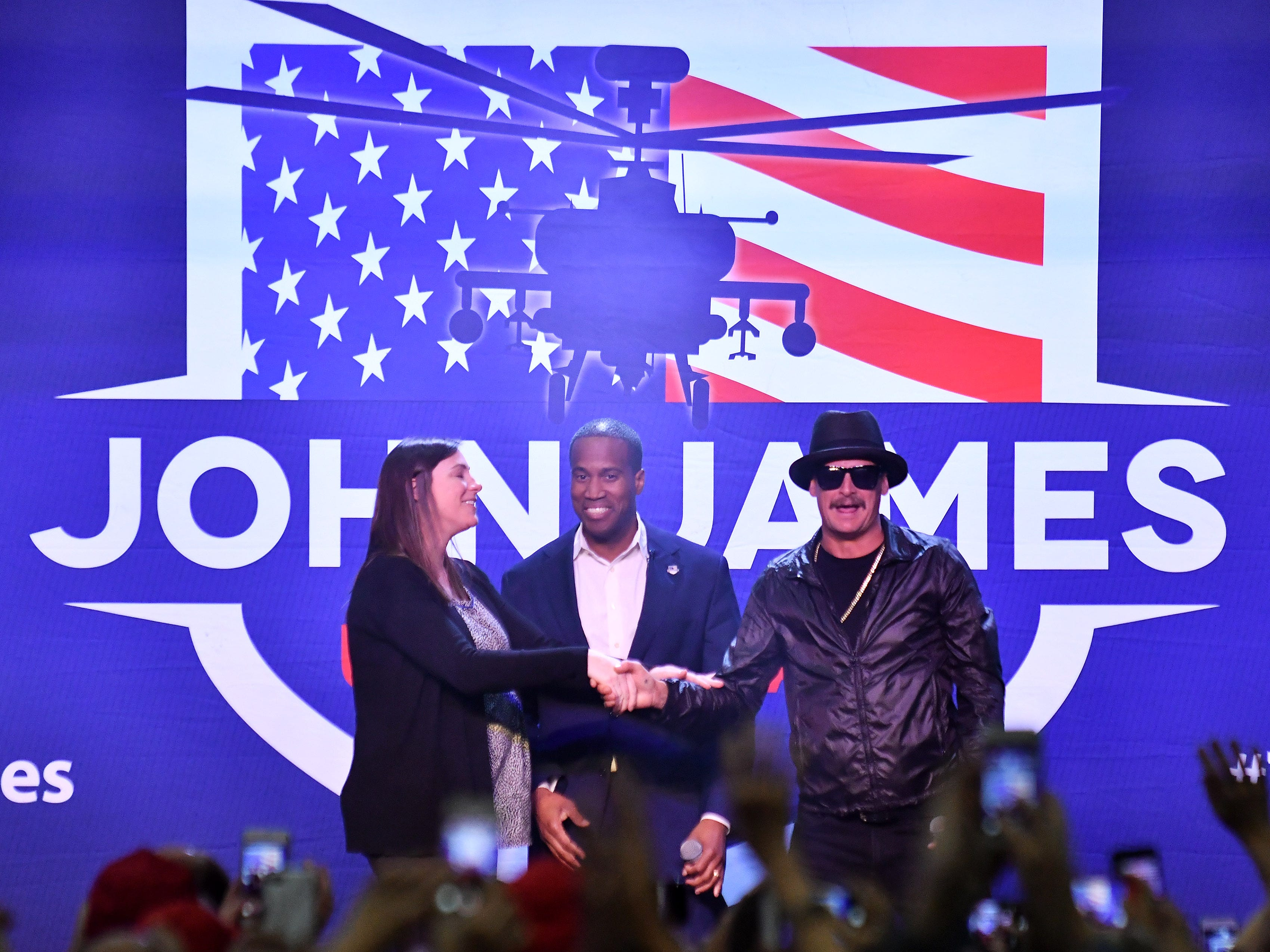Kid Rock introduces John James and his wife Elizabeth, left, during the rally.