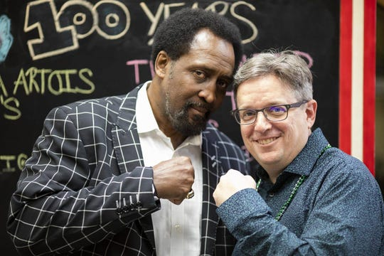 "Former boxer Thomas ""Hitman"" Hearns, left, celebrates PR guru Jason Brown."