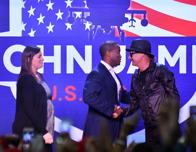 "Kid Rock introduces John James and his wife Elizabeth, left, during the rally.    ""Protect The American Dream Rally"" for Republican candidate for U.S. Senate John James at the Flagstar Strand Theatre in Pontiac, Mich. on Oct 17, 2018."