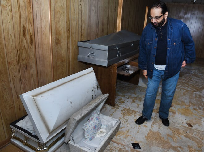 Naveed Syed shows the small casket where some of the remains of 11 infants were found inside the former Cantrell Funeral Home on Saturday October 13, 2018.