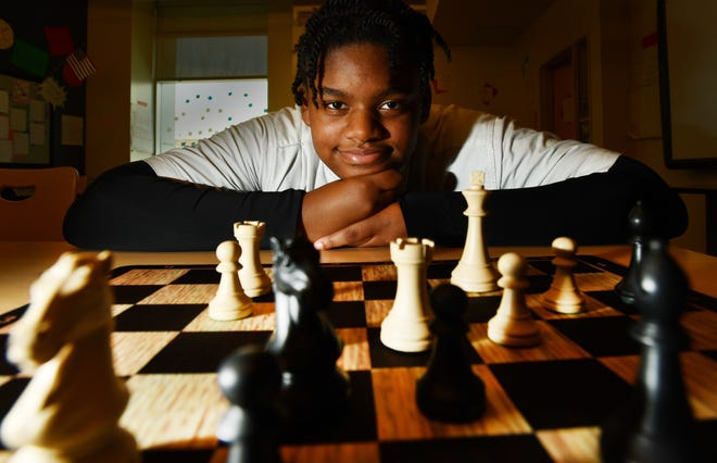 Clarisse Woods, 13, who will compete in the World Chess Championships in Greece, at her chess practice at University Prep Science and Math Middle School in Detroit on Oct. 2.