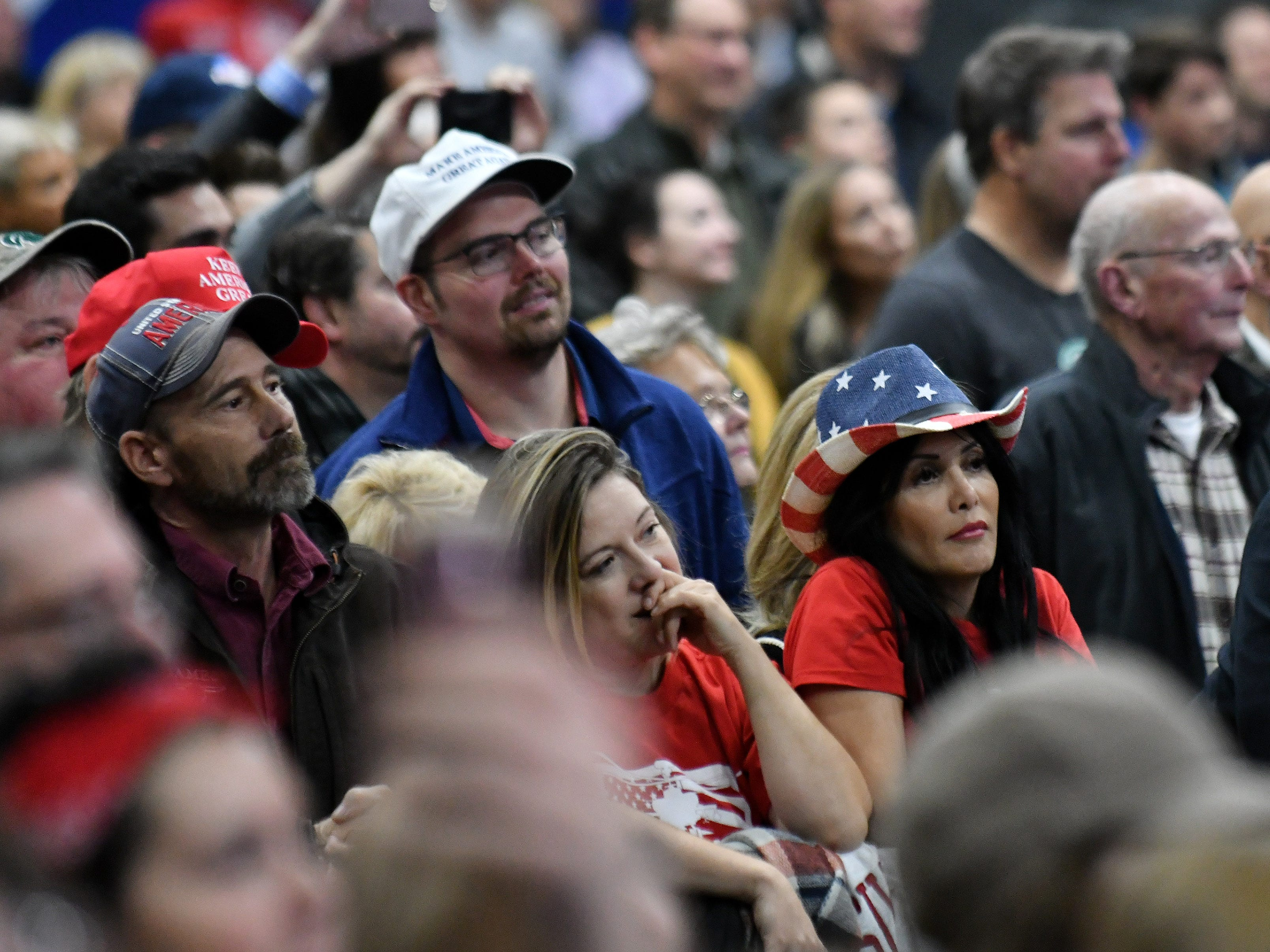 Supporters listen to Ted Nugent during the rally.
