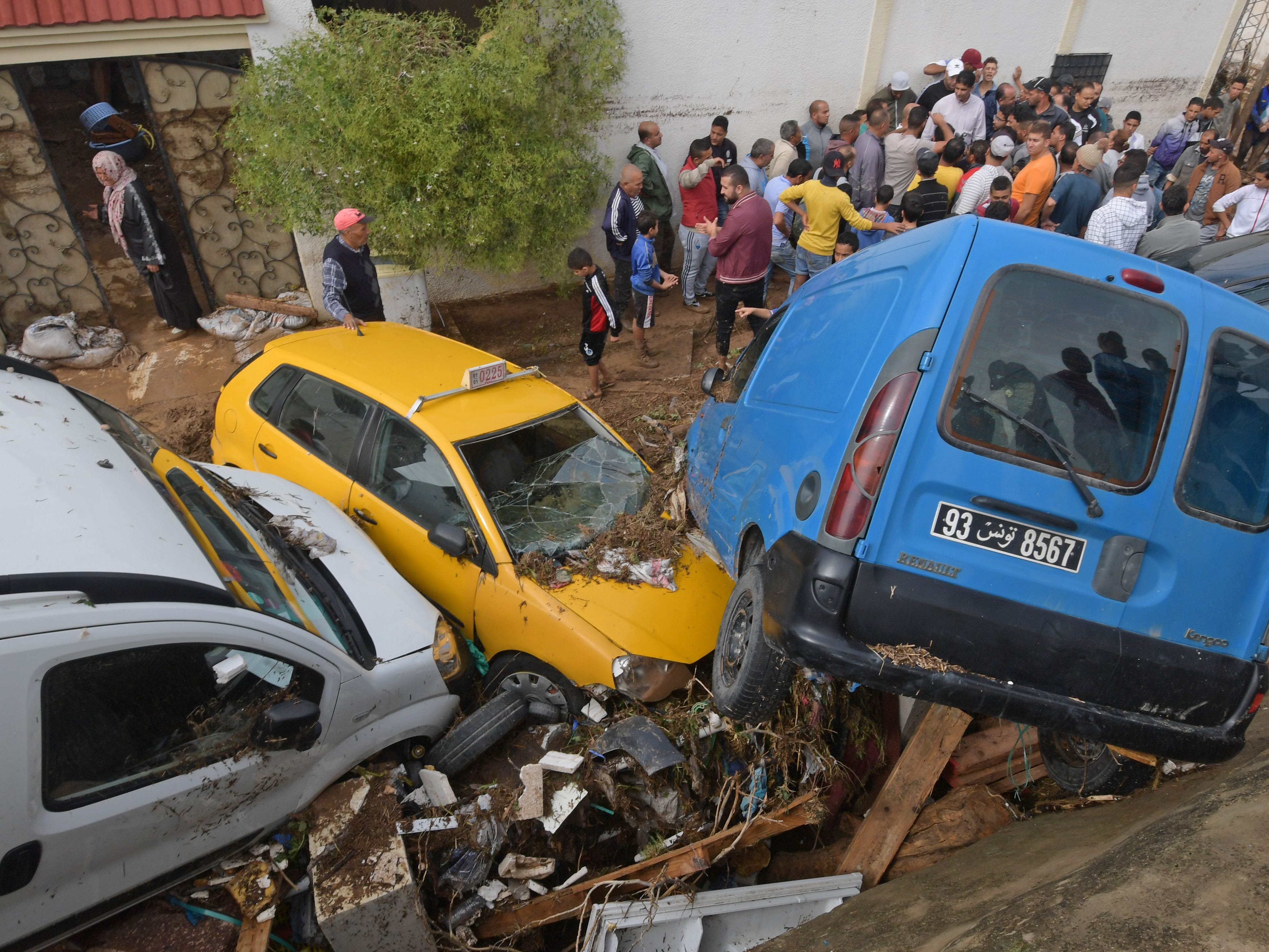 Cars pile up on a street after being swept away by torrential rains in the township of Mhamdia near the Tunisian capital of Tunis on Oct. 18, 2018.