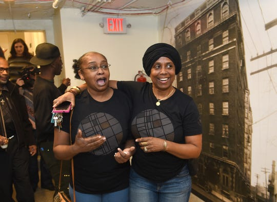 Amelia Norris, left, and Tanya Clark, react to the new community facilities in the lower level of the renovated Hamilton Midtown building in Detroit on Thursday.