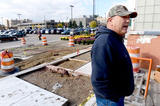 "Ken Penzien of Penzien Farms and Greenhouses in Macomb Township  stands by an area already under construction at the Royal Oak Farmers Market.  ""That used to be where I put my produce,"" he said. ""That's where they say a street is going to go now. No room for me anymore."""