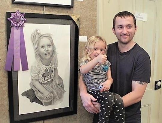 Randy Owen and his young model celebrate best of show and people's choice awards in adult fine art at the recent Pennsylvania Apple and Cheese Festival in Canton.