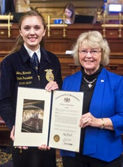 Pennsylvania state Rep. Tina Pickett, right, honors Jenna Harnish of Ulster at the state capitol after Harnish was named state FFA (Future Farmers of America) president.
