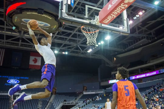 UE's Deandre Williams (13) flies high as he participates in the dunk contest during the 2018 Hoopfest at the Ford Center Wednesday Oct. 17, 2018.