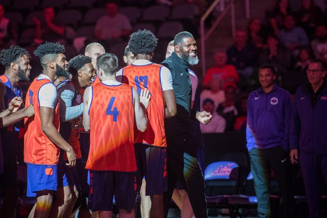 University of Evansville men's basketball head coach Walter McCarty is cheered on by his players during the 2018 Hoopfest at the Ford Center Wednesday Oct. 17, 2018.