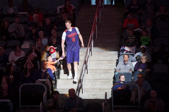 UE's Evan Kuhlman (10) hands a shirt to a fan after being announced during the 2018 Hoopfest at the Ford Center Wednesday Oct. 17, 2018.