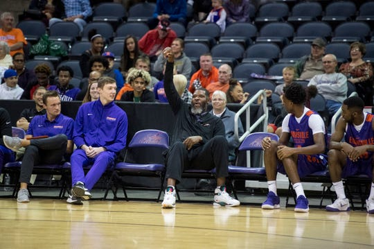 Head Coach Walter McCarty makes a basket from the bench during the 2018 Hoopfest at the Ford Center Wednesday Oct. 17, 2018.