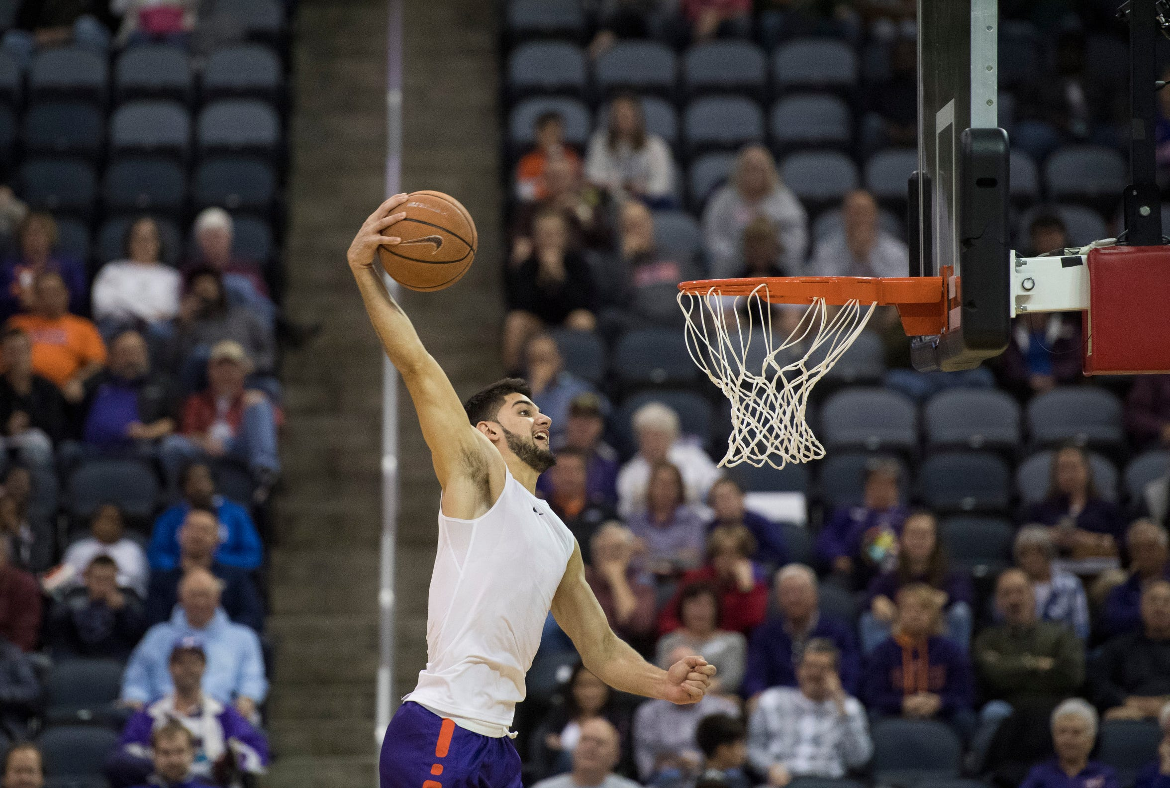 Aces guard Sam Cunliffe pulls off a tomahawk during the dunk contest of the 2018 Hoopfest event at Ford Center.