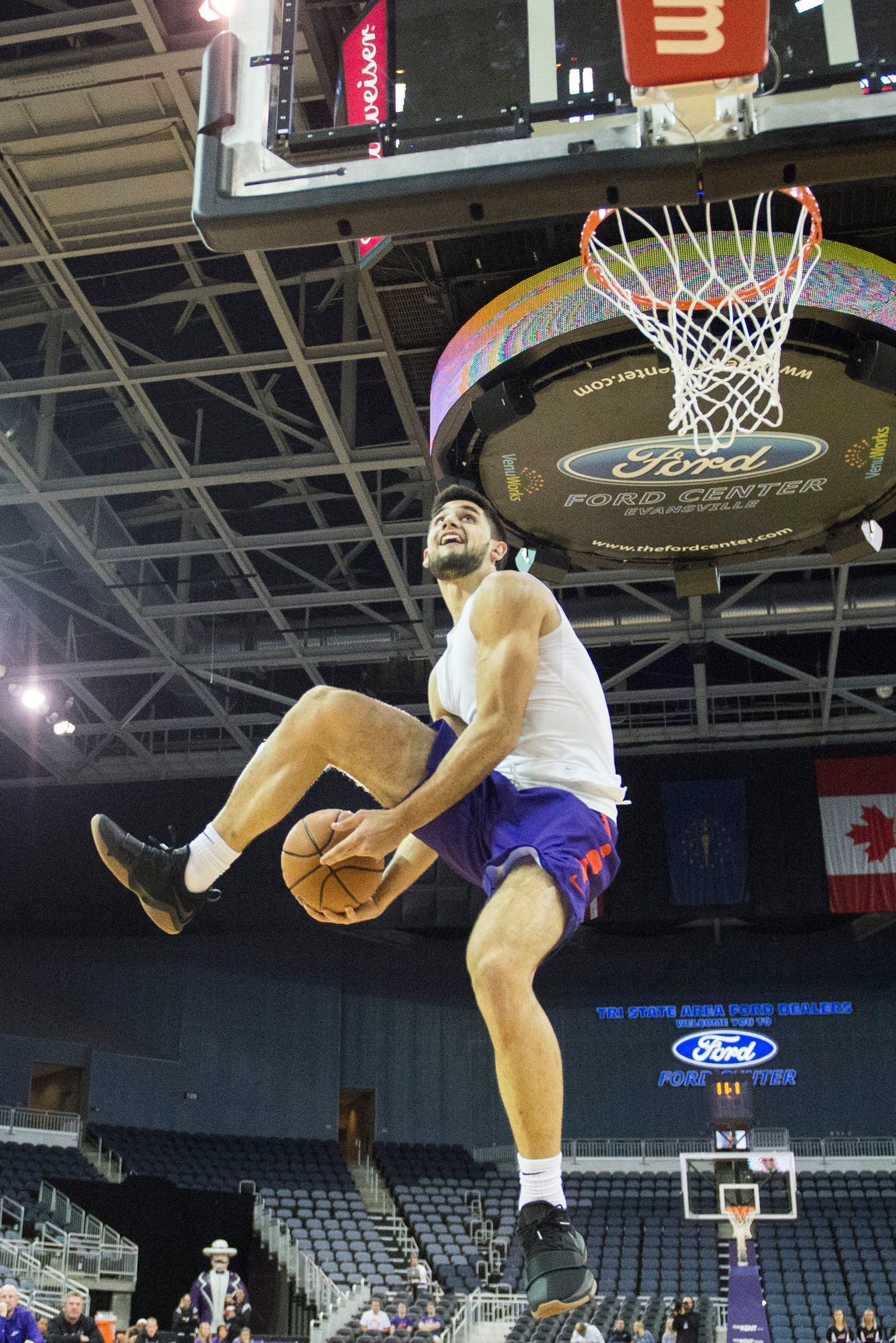 UE's Sam Cunliffe goes for a between the legs dunk during the dunk contest of the 2018 Hoopfest at the Ford Center Wednesday Oct. 17, 2018.