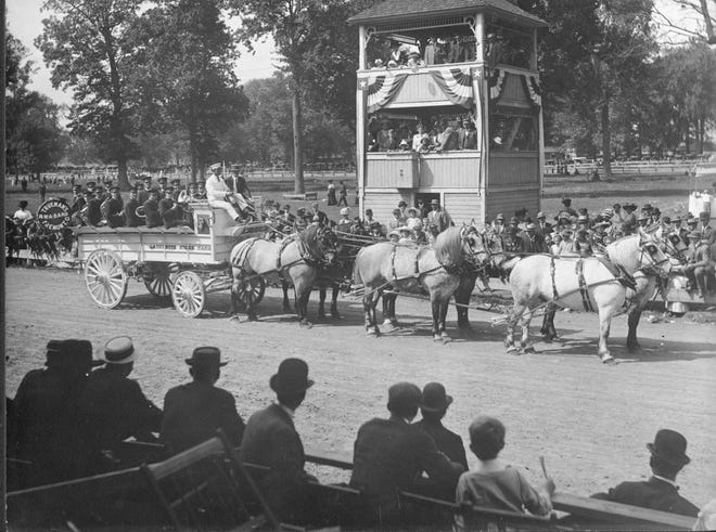Opening day festivities at the track infield drew many at the Sandusky County Fairgrounds around 1915.