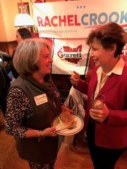 Janet Garrett, right, speaks to Sandra Wise during a visit to Fremont on Wednesday night. Garrett is seeking to unseat incumbent U.S. Rep. Jim Jordan.