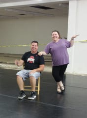 Joe Miller and Beth Kreuscher of Madison Street Dance practice their moves.