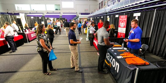 Amazon was at a hiring event in October put on by CareerSource Southwest Floridaat the Fort Myers campus of Florida SouthWestern State College. More than 75 local employers with hundreds of positions to fill attended the one-day event. Businesses are hiring and expanding, but feeling less optimistic than they were a year ago, according to a new business climate survey.