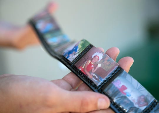 Savannah Harmon shows one of her belt designs that you can customize with personal photos.