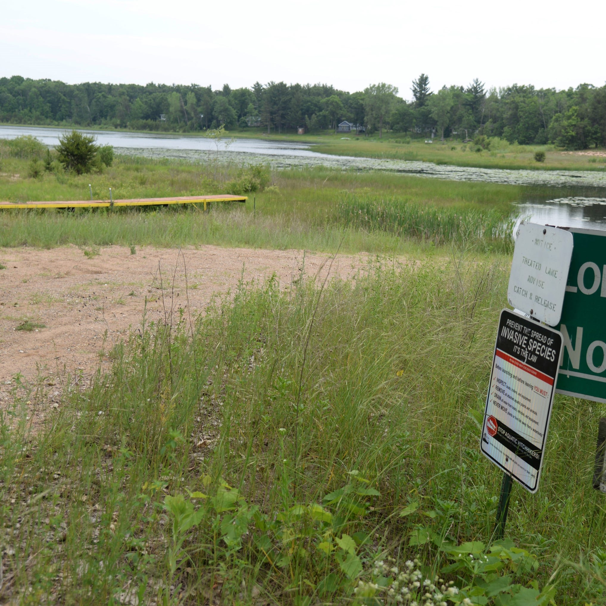 This dry boat landing at Long Lake in Waushara County might symbolize Wisconsin's conservation programs the past eight years.