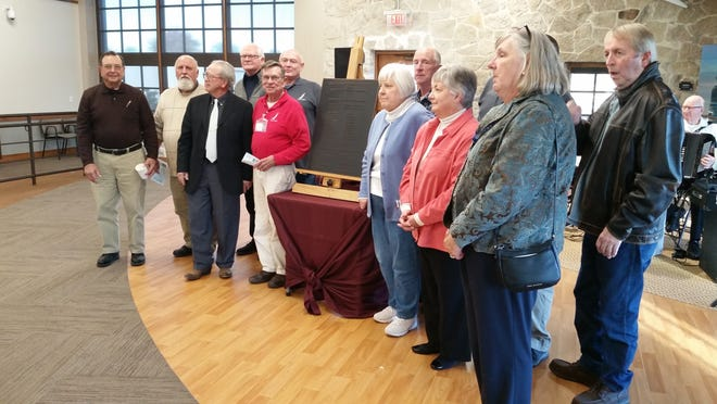 State and local officials gathered inside the former Sturgeon Bay highway shop Wednesday to formally dedicate the new uses of the more than 80-year-old structure.