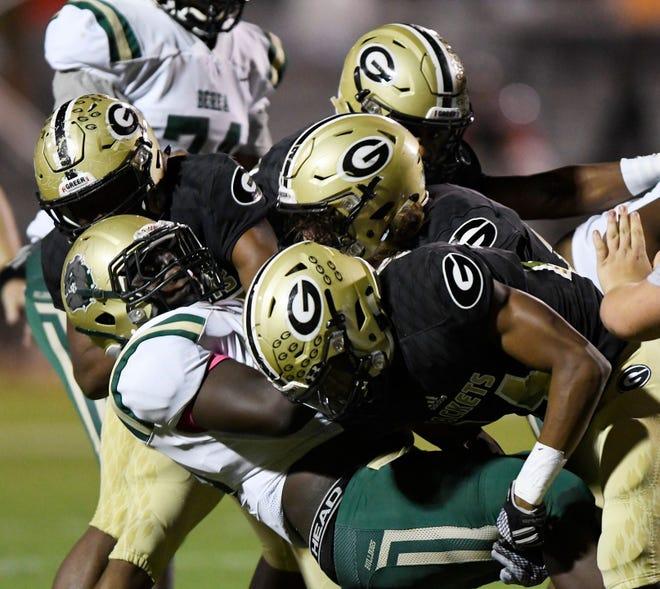 A bevy of Greer defenders take down Berea's Ty Simpson during the Yellow Jackets' 55-0 win in Week 8.