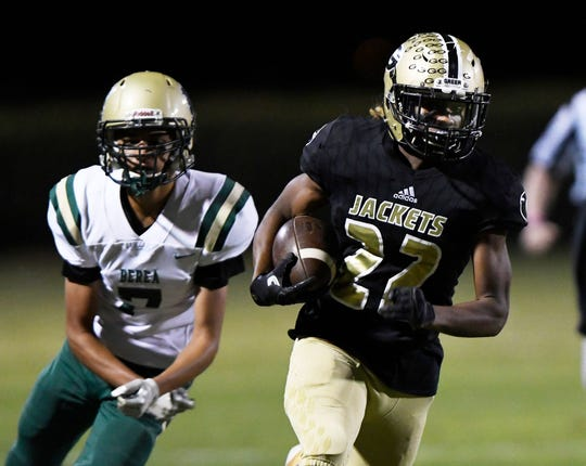"Greer coach Will Young is impressed with the work ethic of Dre Williams (22): ""He's by far the hardest-working (running back) we've had."""