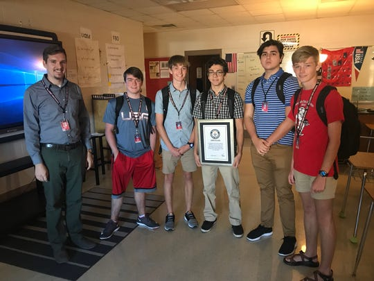 Hillcrest High physics teacher Scott Buhr with some of the students who took part in an experiment that set a record in the Guinness Book of World Records. Left to right are Zachary Shipman, Jacob Kerby, Amjad Omer, Kamil Czerkas and Joseph Kerby.