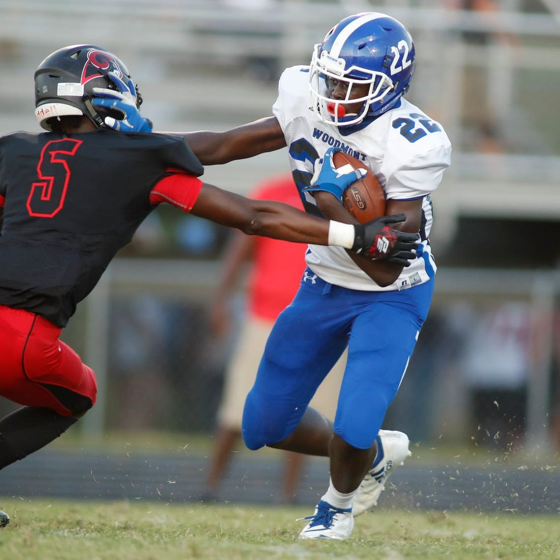 Woodmont's leading rusher, sophomore Joshua Kamoto (22), has gained 573 yards and scored seven touchdowns.