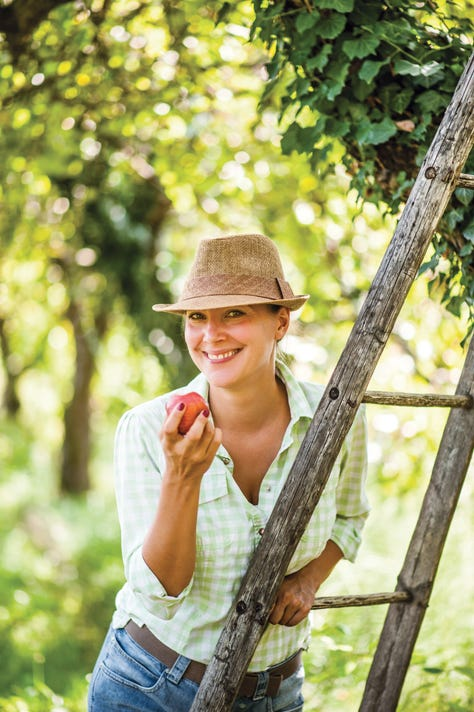 Young Woman Enjoying A Fresh Apple
