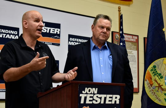 This Aug. 31, 2018 photo shows Montana U.S. Sen. Jon Tester, right, listening to Brandon Judd, president of the National Border Patrol Council, speak about border security and immigration during a campaign event in Billings, Mont. Outside groups and donors have poured more than $45 million into the race between Tester and Republican State Auditor Matt Rosendale. (AP Photo/Matthew Brown)