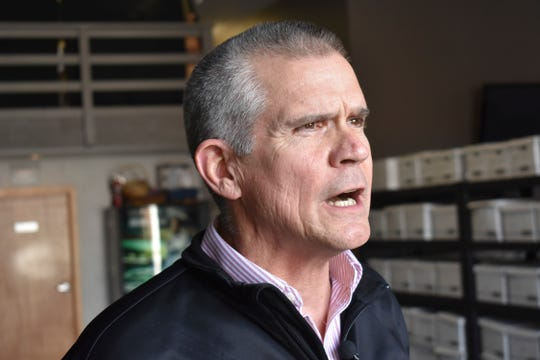In this Oct. 6, 2018 photo Republican State Auditor Matt Rosendale discusses his campaign to defeat Montana Democratic U.S. Sen. Jon Tester at a campaign event at Lonewolf Energy in Billings, Mont. Rosendale trails in fundraising but he's stayed competitive with $14 million spent by deep-pocketed conservative groups on his behalf. (AP Photo/Matthew Brown)
