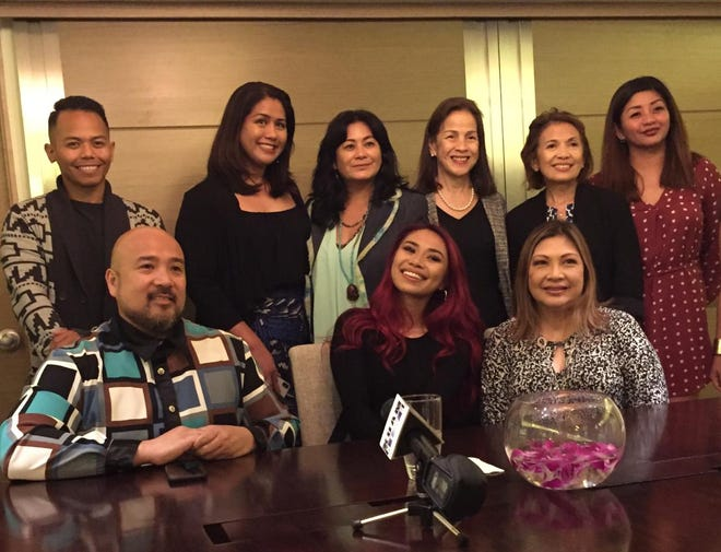 Jessica Sanchez, center, is joined by FCG President Norman Analista, bottom left, and sponsors for the Filipino Community of Guam's 64th Anniversary Ball set for tomorrow night.