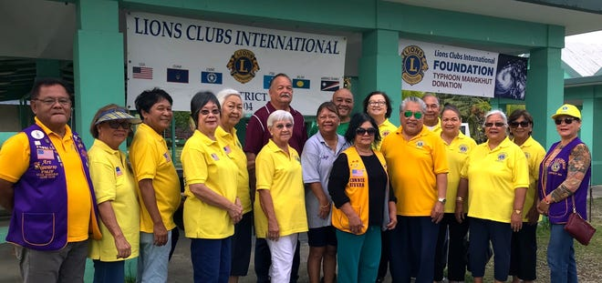 Lions from LCI District 204 distributed relief goods on October 15 to residents of Agat and Santa Rita who were impacted by Typhoon Mangkhut. The relief goods were purchased from an emergency grant from the Lions Clubs International Foundation. Pictured from left: Lions Art Navarro, Jill Pangelinan, Roger Ballon, Marietta Camacho, Lola Flores, Helen Mendiola, Jojo Pillsbury, Connie Rivera, District Governor Danny Cruz, Julie Cruz, Helen Colby, Mary Taitano, and Blanca Imbo. Back row from left: Santa Rita Mayor Dale Alvarez, Agat Vice-Mayor Chris Fejeran, and Lions Doris Limtiaco and Pete Babauta.