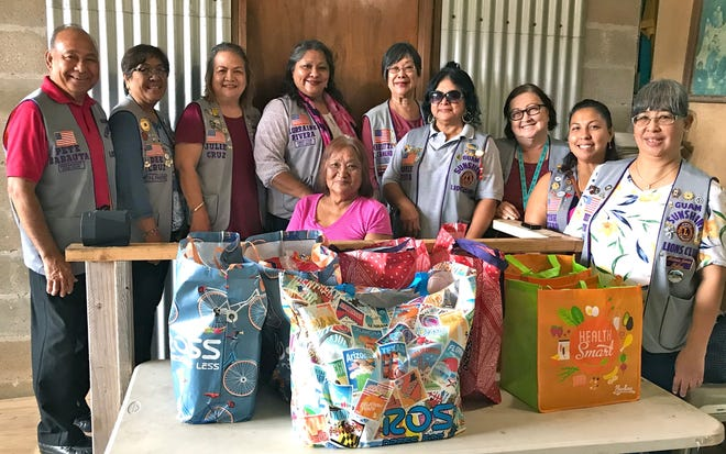 "Guam Sunshine Lions Club members visited Rosita Payas, 76, (seated) at her residence in Agat on October 17. The members, whose primary club project is ""Caring for the Sick and the Elderly, brought supplies, song and cheer to the Agat resident. Standing from left: President Pete Babauta,  Dee Cruz, Julie Cruz, Lorraine Rivera, Marietta Camacho, Connie Rivera, Doris Limtiaco, Tish Tano, and Annie Artero."