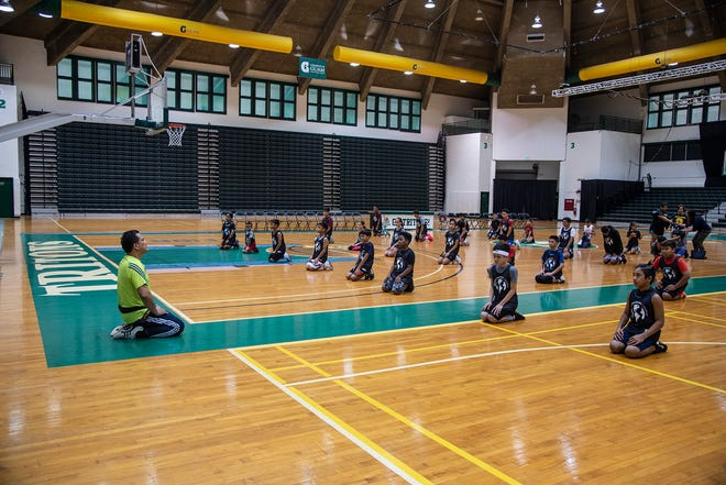 Guam Taekwondo Center chief instructor, Master Noly Caluag teaches meditation to about 50 boys and girls ages 10 - 17 at the University of Guam last Sunday.  He was invited by professional basketball player/trainer Eric Dailey to conduct the warm-up and some cross training exercises for the free basketball clinic sponsored by the Aklan Association.