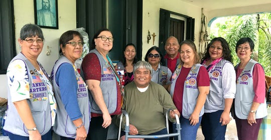 """Guam Sunshine Lions Club members visited Henry T. Duenas, 63, at his residence in Talofofo on October 17. The club, whose primary service project is """"Caring for the Sick and the Elderly,"""" brought a walker, supplies, as well as songs and cheer to Duenas. Pictured from left: Lions Annie Artero, Dee Cruz, Doris Limtiaco, Tish Tano, Connie Rivera, Pete Babauta, Julie Cruz, Lorraine Rivera and Marietta Camacho."""
