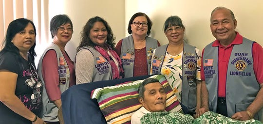 Guam Sunshine Lions Club members brought supplies, song, and cheer to Ben DeLeon, 81, at his home in Dededo on October 17, 2018. Pictured from left: Lou DeLeon; Lions Marietta Camacho, Lorraine Rivera, Doris Limtiaco, Annie Artero, and President Pete Babauta.