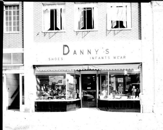 Danny's Shoes and Infants Wear at 212 N. Main St., a building that no longer exists, apparently from the 1950s or 1960s. It was called The Danny Shoppe run by Joseph R. Dannheiser in 1944. For about 25 years in the first part of the 1900s it housed Frank and Mary Cimini's fruit company. They lived upstairs at the time.