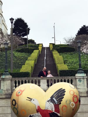 Josh Jenkins poses with his daughter, Hallie, on the Lyon Street Steps in San Francisco in April, 2018.