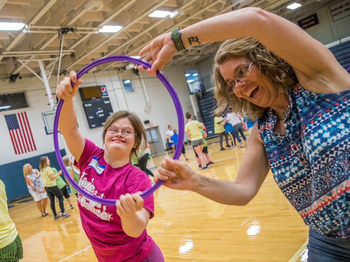 Mickey Deputy (middle) and her mother, Jenny (right), practice for an upcoming dance performance during Live Laugh Dance on Tuesday, July 10, 2018. The summer program, for young adults with Down syndrome, promotes movement and social interaction through dance. This is the eighth year of the program that was started by IUPUI.