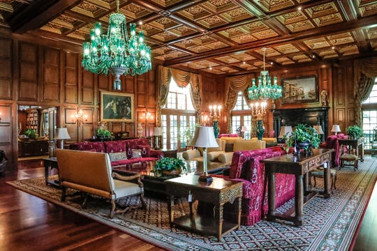 The great hall offers large seating areas for guests.