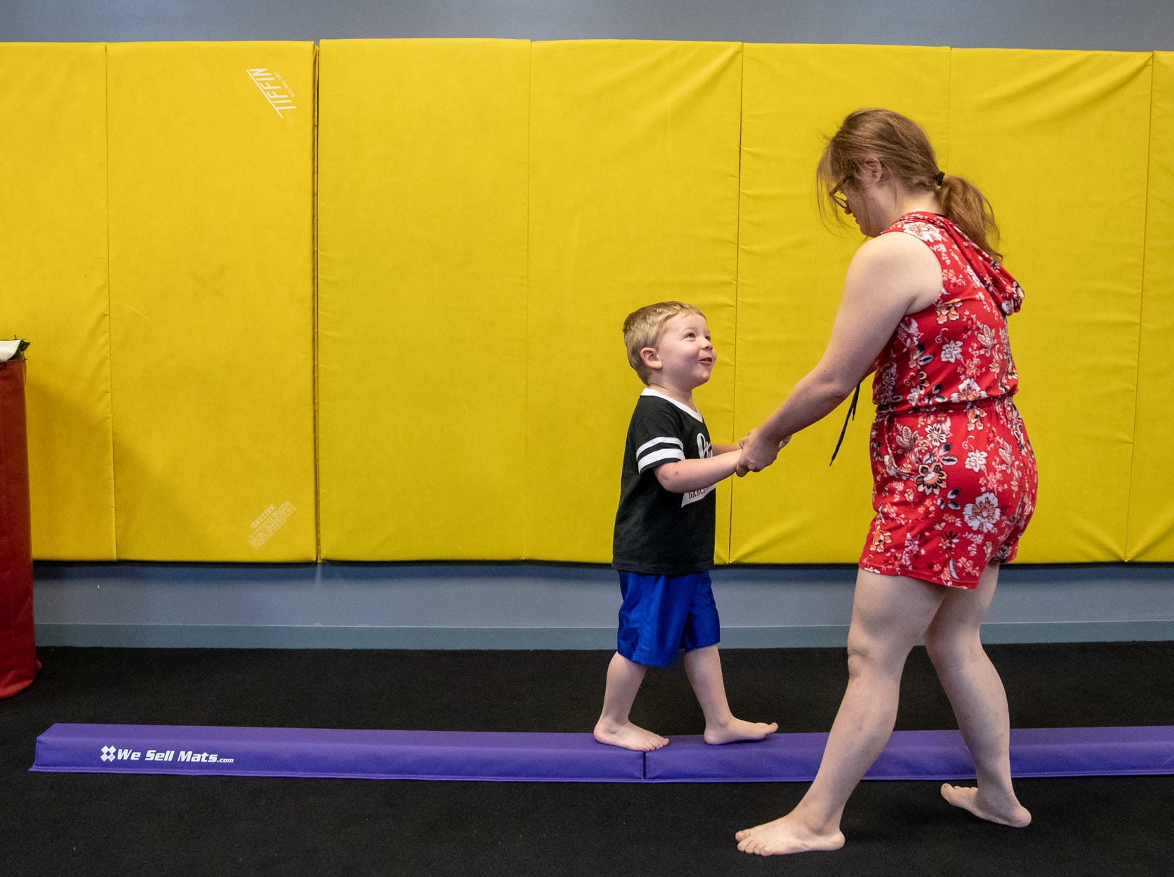 Mickey assists student Owen Riley, 3, during gymnastics class at Style Dance Academy in Franklin, Ind., on Tuesday, Oct. 9, 2018.