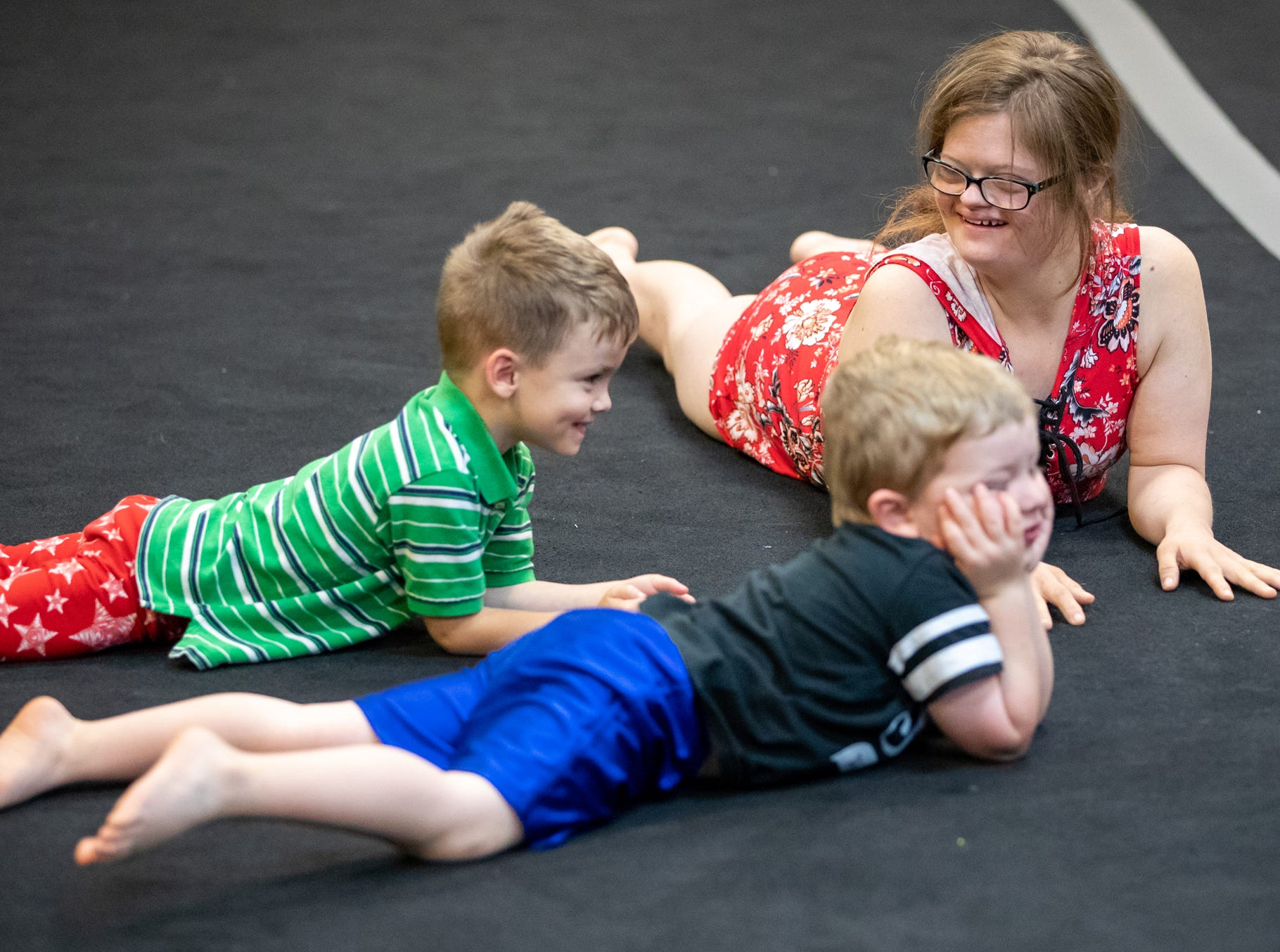 Mickey Deputy warms up for gymnastics class with her students, Max Black, 4, and Owen Riley, 3, at Style Dance Academy in Franklin, Ind., on Tuesday, Oct. 9, 2018.