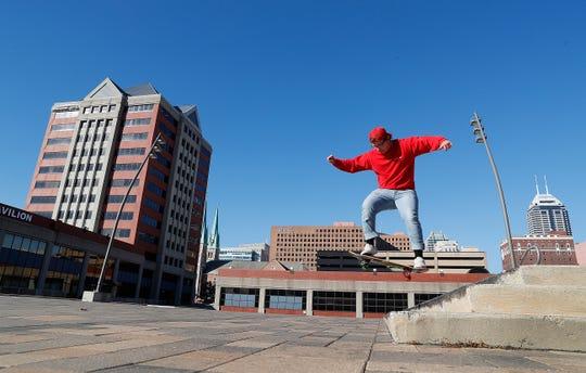 Ty Conatser skateboards on the Pam Am Plaza steps on Wednesday, Oct. 17, 2018.