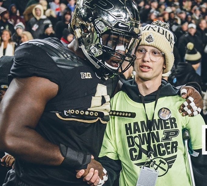 "Fans at Purdue's football game Saturday will chant ""Cancer sucks"" for Tyler Trent (right), who is fighting his third battle with bone cancer."