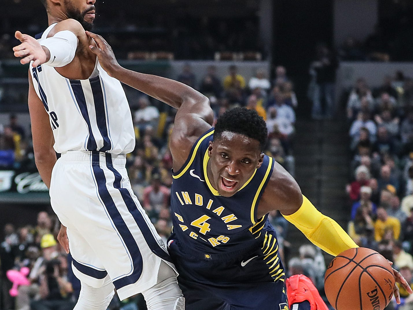 Indiana Pacers guard Victor Oladipo (4) is fouled by Memphis Grizzlies guard Garrett Temple (17) during the first half of the season opener at Banker's Life Fieldhouse in Indianapolis, Wednesday, Oct. 17, 2018.